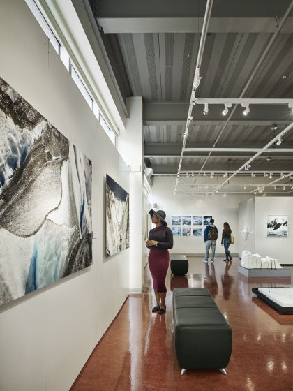 Young women viewing art work